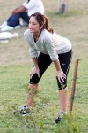 "Minka Kelly warms up to film a jogging scene for her latest movie, ""The Roommate"""